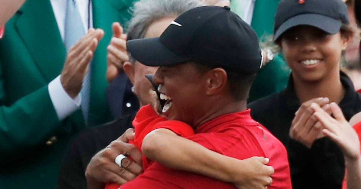 tiger woods embraces his kids after his 2019 masters win