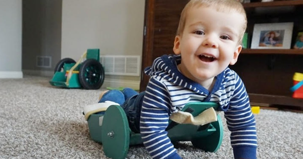 Dad invents 'Frog' device to help 2-year-old son with spina bifida crawl on his own