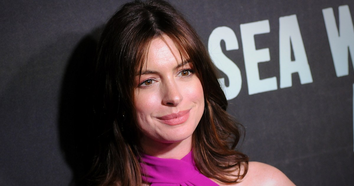 Pregnant Anne Hathaway glows in gorgeous dress made for 'me and the bump'