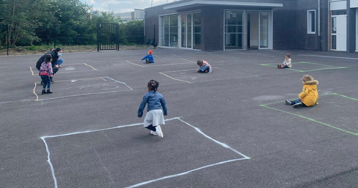 Heartbreaking photo shows French preschoolers playing in chalk squares