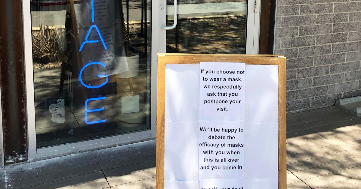 This vintage store's sassy sign about wearing masks makes quite the statement