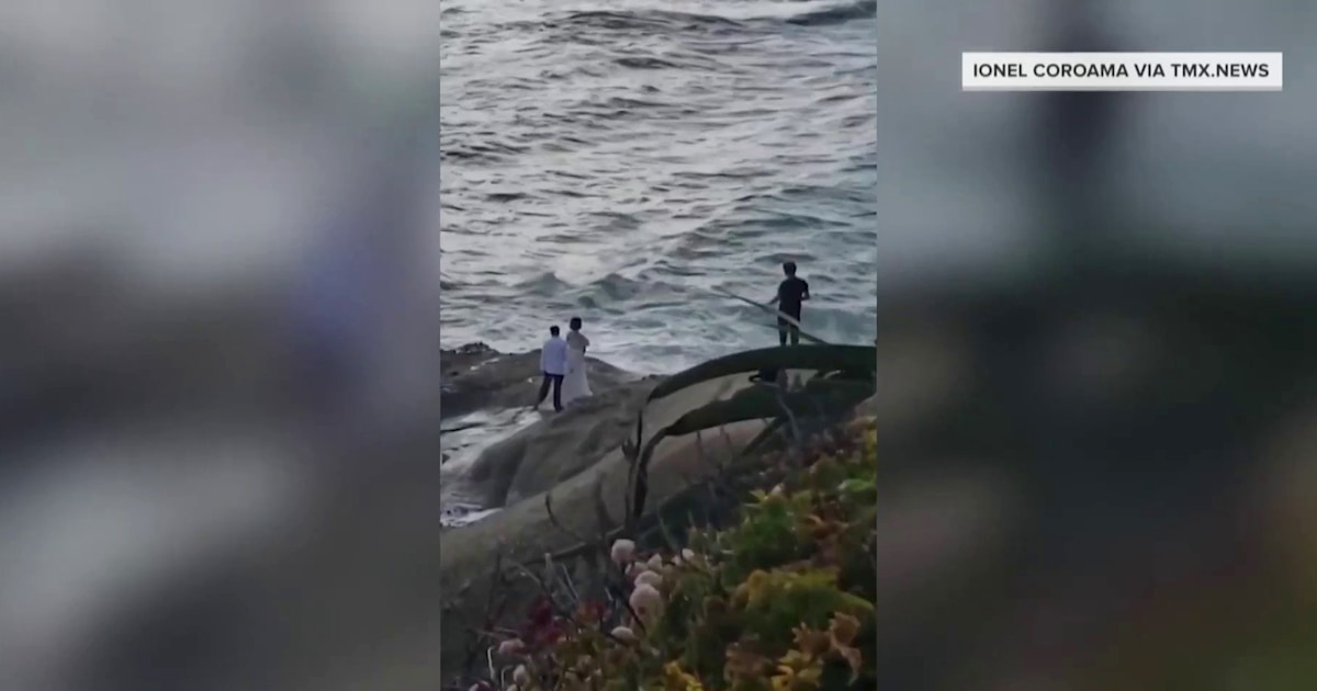 Heart-stopping video shows bride and groom swept out to sea while taking photos
