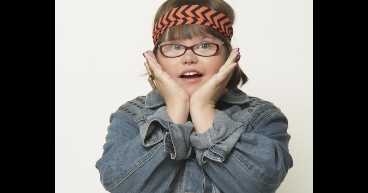 Teenager With Downs Syndrome Signs To Five Different