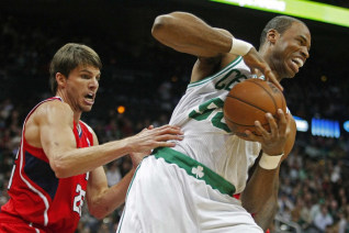 Image: Celtics center Collins grabs a rebound away from  Hawks guard Korver in the first half of their NBA basketball game in Atlanta
