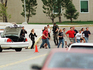 Students run from Columbine High School run under