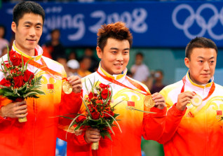 Image: Chinese gold winners Wang Liqin, Wang Hao, and Ma Lin