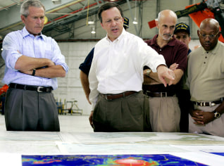 IMAGE: President Bush, FEMA head Michael Brown and Secretary Michael Chertoff