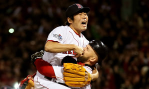 Image: Koji Uehara #19 of the Boston Red Sox celebrates with David Ross #3 after defeating the St. Louis Cardinals