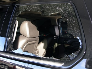 Image: Damage of Tiger Woods' Cadillac Escalade's rear window from his single car accident is seen in Orlando