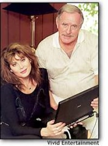 Photo: Vivid Entertainment President David James and Lisa, a model and tester