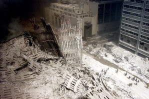 A September 11, 2001 file photo shows firefighters walking amid rubble of the World Trade Center in New York
