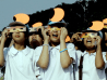 Image: Thai school children look at a partial solar eclipse through filters