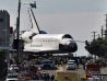 Image: Space shuttle Endeavour makes a right turn onto Manchester Ave. in Los Angeles.