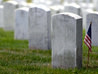 A flag decorates a grave during Memorial Day ceremonies at Arlington National Cemetery near Washington