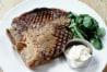 Steak on white plate --- Image by © Frank Bauer/zefa/Corbis