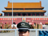 Image:  Chinese security officer stand guards