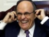 New York City Mayor Rudolph Giuliani laughs as he