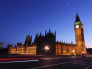Image: A car travels along Westminster Bridge past the Houses of Parliament in London.