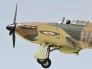 Image: A World War II RAF Hawker Hurricane fighter aircraft performs during an air display at the Farnborough Airshow