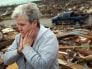 Image: Woman looks at tornado aftermath in Joplin, Missouri