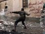 Image: A Free Syrian Army fighter throws a homemade bomb towards forces loyal to Syria's President Bashar al-Assad in Deir al-Zor