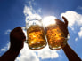 Image: Revellers toast with beer during Oktoberfest in Munich.
