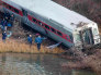 Image: Emergency workers examine the site of a Metro-North train derailment in the Bronx borough of New York