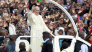 Image: Pope Francis waves to the faithful as he arrives for a Papal mass in Kenya's capital Nairobi