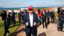 Image: Donald Trump is surrounded by members of the media as he arrives at the Women's British Open golf championship at the Turnberry golf club in Turnberry