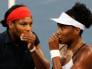 Serena Williams of the U.S. speaks with her sister and teammate Venus during their women's doubles semifinal tennis match against Kateryna and Alona Bondarenko of Ukraine at the Beijing 2008 Olympic Games