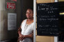Martha-Renée Kolleh, a cafe owner who has put up a sign telling customers she is black because she is fed up with people walking out when they see the colour of her skin.
