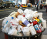 A garbage bin sits full after the Macy's Thanksgiving Day Parade in New York