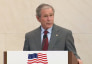 Former President George W. Bush delivers remarks at a naturalization ceremony.