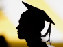 File picture shows the silhouette of a student with a graduation cap during a diploma ceremony at the John F. Kennedy School of Government