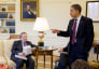 Larry Summers, left, sits while President Barack Obama speaks in the Oval Office in 2010.