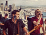 Seattle band Mudhoney play atop the city's Space Needle.