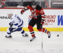 New Jersey Devils' Kovalchuk leaps over the puck in front of Tampa Bay Lightning's Stamkos in their NHL game in Newark
