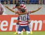 Donovan of the U.S. is embraced by Corona after scoring a goal during the second half of their CONCACAF Gold Cup quarter-final soccer match against El Salvador in Baltimore