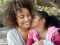 Image: Daughter kissing mother on cheek, Mother's Day makeover