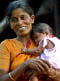 Indian fisherwoman carries her child in the Nagapattinam district
