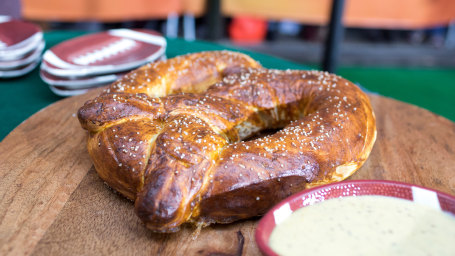 Brandi Milloy's tailgate recipes for bacon crack, chocolate chip cookie dough footballs and a super-sized victory pretzel