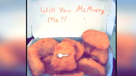 Man proposes with ring inside chicken nuggets box