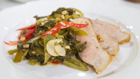 Michael Lomonaco's pork chop with vinegar peppers and broccoli rabe