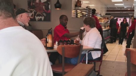 This IHOP waiter helps a woman with a disability eat and we're in tears