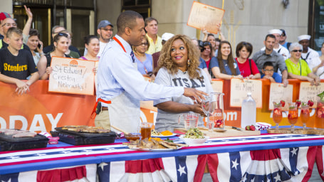 TODAY's Craig Melvin and Sunny Anderson cooking on the plaza.