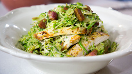 "Alejandra Ramos' Warm Brussels Sprouts Chicken Caesar Salad with Bacon ""Croutons"""