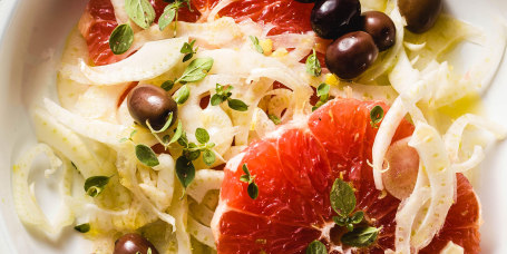 Fresh delicious salad of fennel, grapefruit and olives. Healthy Vegan Mediterranean Recipe