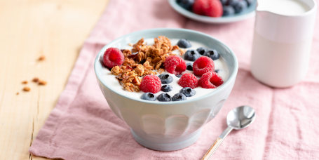 Yogurt with granola and berries in bowl