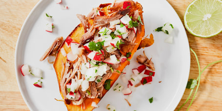 Loaded Pulled Pork Sweet Potatoes