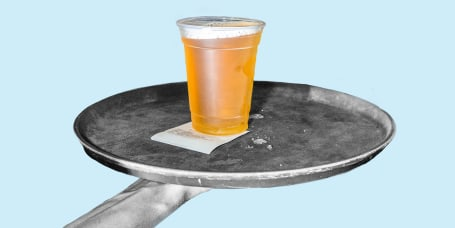 Plastic cup of cold beer on trap